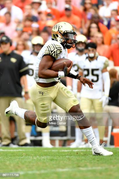 Quarterback Kendall Hinton of the Wake Forest Demon Deacons runs the football against the Clemson Tigers during the game at Memorial Stadium on...
