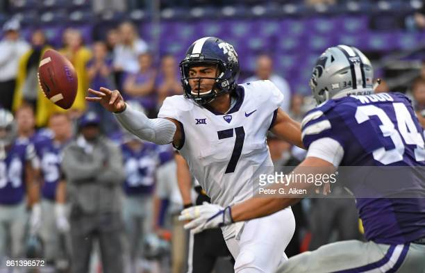 Quarterback Kenny Hill of the TCU Horned Frogs pitches the ball to the outside against the Kansas State Wildcats during the second half on October 14...