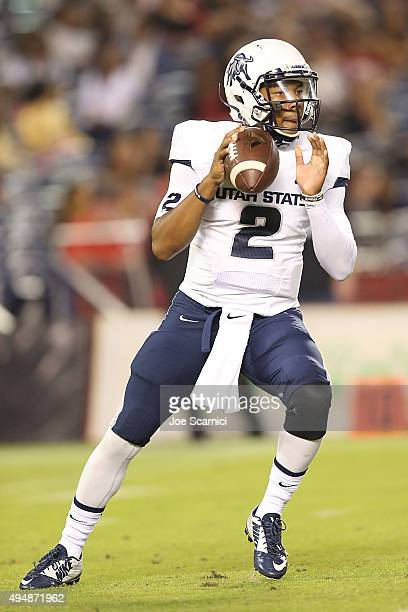 Quarterback Kent Myers of the Utah State Aggies looks to throw the ball in the first quarter against the San Diego State Aztecs at Qualcomm Stadium...