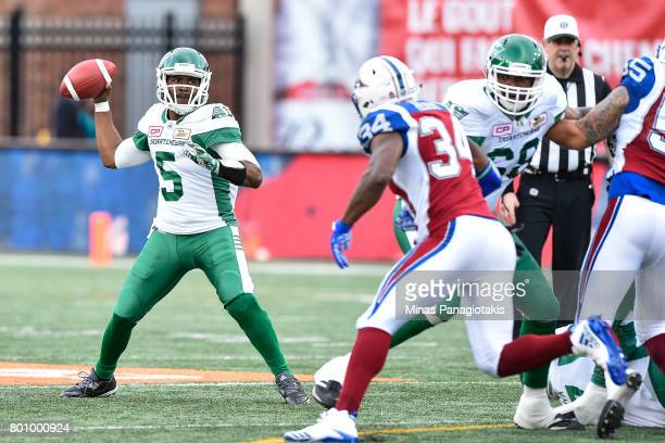 Quarterback Kevin Glenn of the Saskatchewan Roughriders looks to play the ball against the Montreal Alouettes during the CFL game at Percival Molson...