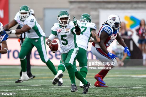 Quarterback Kevin Glenn of the Saskatchewan Roughriders runs with the ball against the Montreal Alouettes in the first half during the CFL game at...