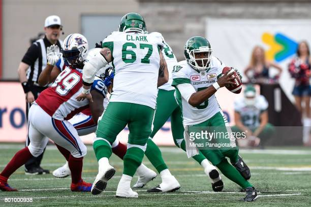 Quarterback Kevin Glenn of the Saskatchewan Roughriders runs with the ball against the Montreal Alouettes during the CFL game at Percival Molson...