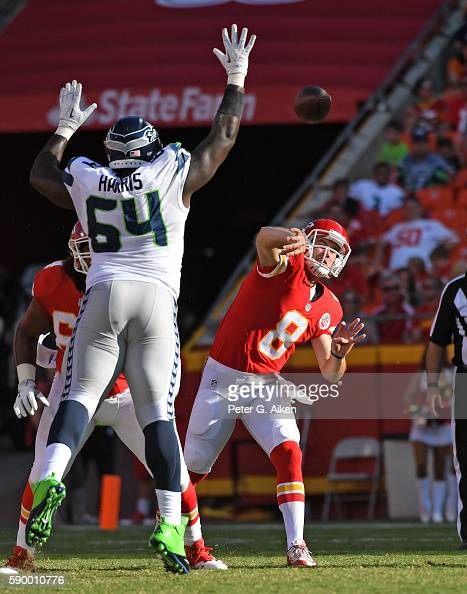 Quarterback Kevin Hogan of the Kansas City Chiefs throws a pass against pressure from defensive tackle DeAngelo Tyson of the Seattle Seahawks during...