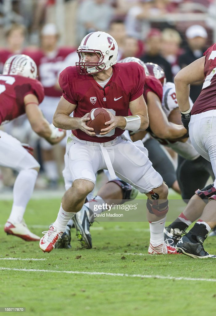 Quarterback Kevin Hogan #8 of the Stanford Cardinal hands off during a PAC 12 football game against the Washington State University Cougars played at Stanford Stadium on October 27, 2012 in Palo Alto, California.