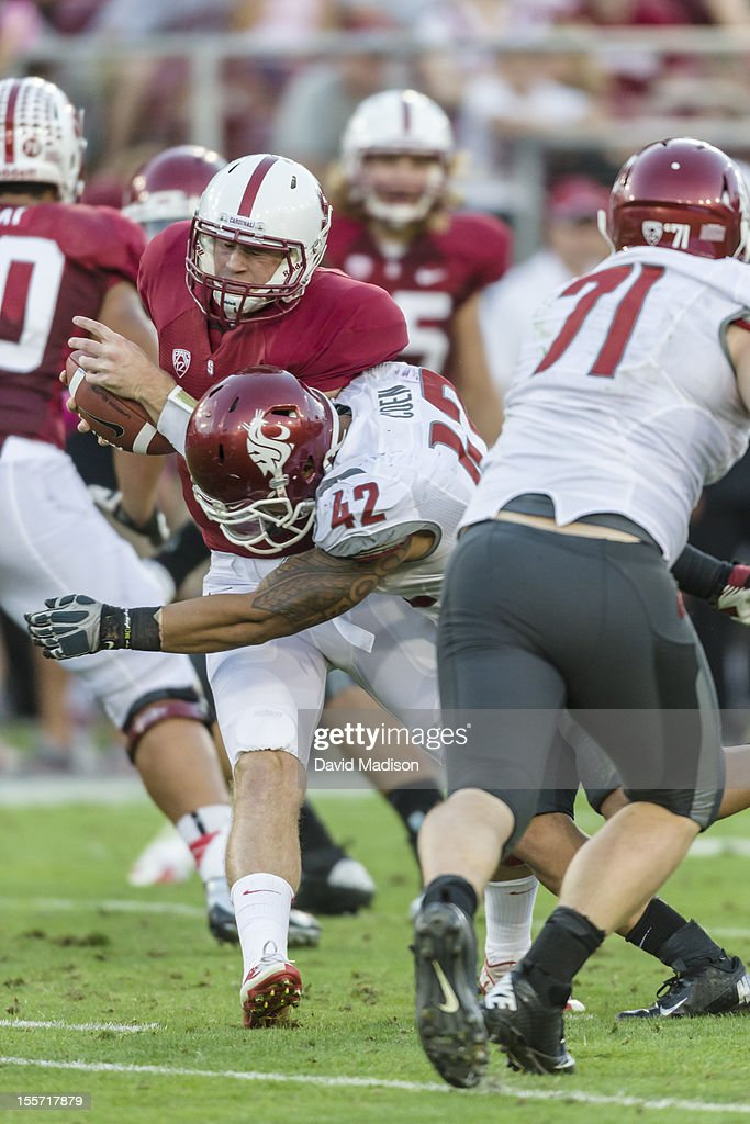 Quarterback Kevin Hogan #8 of the Stanford Cardinal is sacked by Cyrus Coen #42 of WSU during a PAC 12 football game against the Washington State University Cougars played at Stanford Stadium on October 27, 2012 in Palo Alto, California.