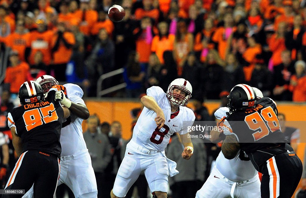 Quarterback <a gi-track='captionPersonalityLinkClicked' href=/galleries/search?phrase=Kevin+Hogan&family=editorial&specificpeople=6780512 ng-click='$event.stopPropagation()'>Kevin Hogan</a> #8 of the Stanford Cardinal passes the ball during the first quarter of the game against the Oregon State Beavers at Reser Stadium on October 26, 2013 in Corvallis, Oregon.