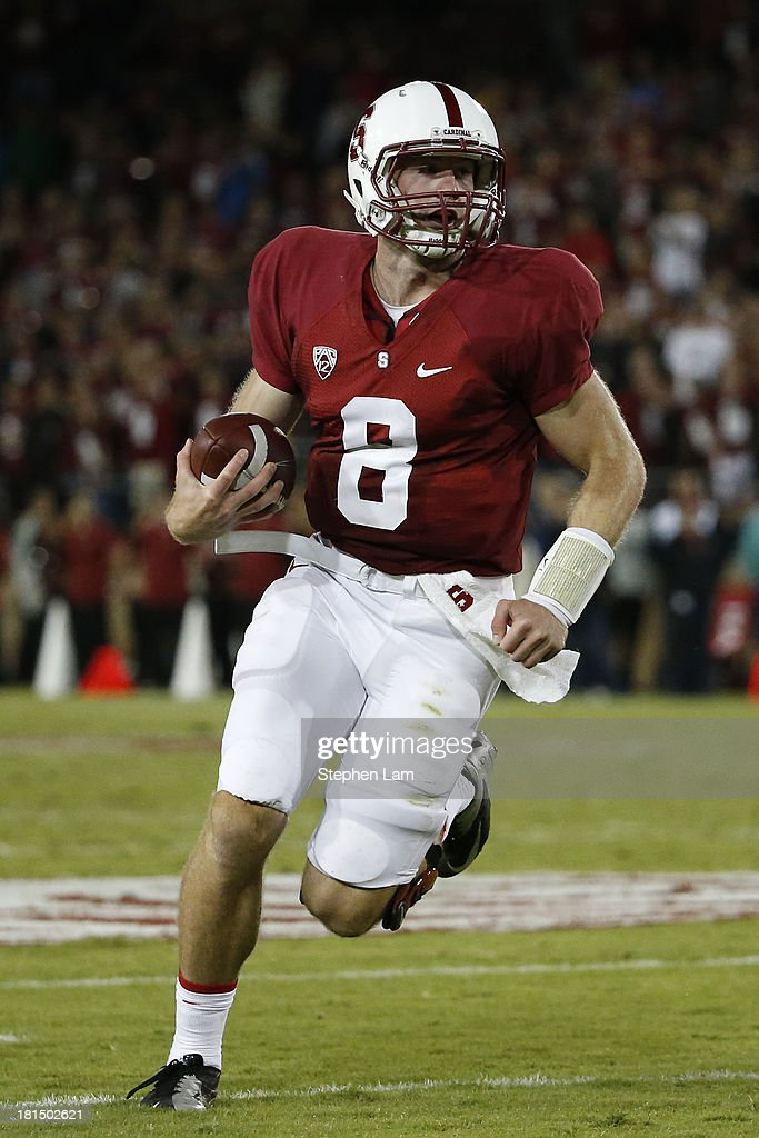 Quarterback <a gi-track='captionPersonalityLinkClicked' href=/galleries/search?phrase=Kevin+Hogan&family=editorial&specificpeople=6780512 ng-click='$event.stopPropagation()'>Kevin Hogan</a> #8 of the Stanford Cardinal rushes up the field during the fourth quarter against the Arizona State Sun Devils at Stanford Stadium on September 21, 2013 in Stanford, California. The Cardinals defeated the Sun Devils 42-28.