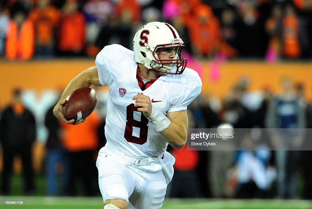 Quarterback <a gi-track='captionPersonalityLinkClicked' href=/galleries/search?phrase=Kevin+Hogan&family=editorial&specificpeople=6780512 ng-click='$event.stopPropagation()'>Kevin Hogan</a> #8 of the Stanford Cardinal scrambles out of the pocket during the first quarter of the game against the Oregon State Beavers at Reser Stadium on October 26, 2013 in Corvallis, Oregon.