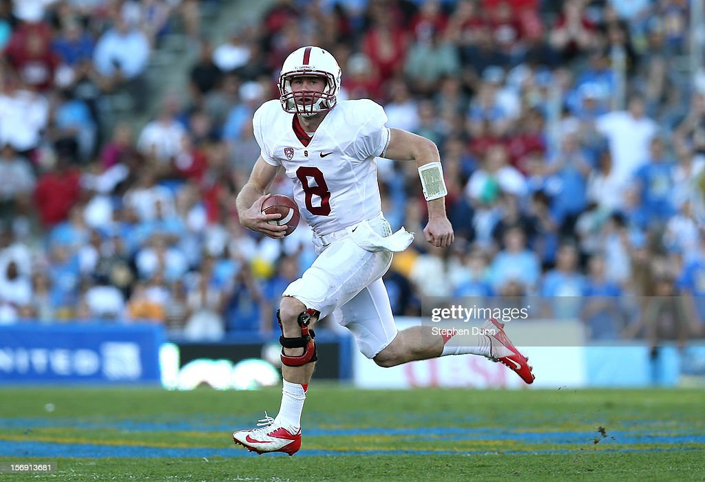 Quarterback Kevin Hogan #8 of the Stanford Cardinal scrambles with the ball against the UCLA Bruins at the Rose Bowl on October 13, 2012 in Pasadena, California. Stanford won 35-17.