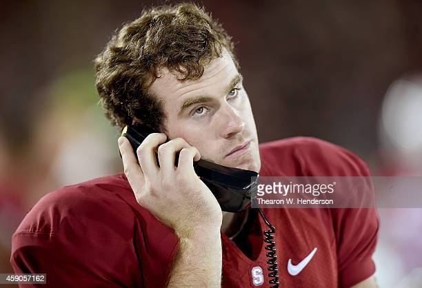Quarterback Kevin Hogan of the Stanford Cardinal talks on the phone with his coaches upstairs against the Utah Utes during the third quarter at...