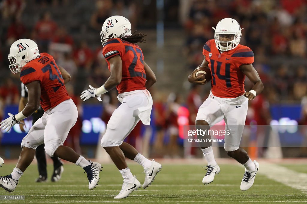 Quarterback Khalil Tate #14 of the Arizona Wildcats scrambles with the football during the second half of the college football game against the Northern Arizona Lumberjacks at Arizona Stadium on September 2, 2017 in Tucson, Arizona.