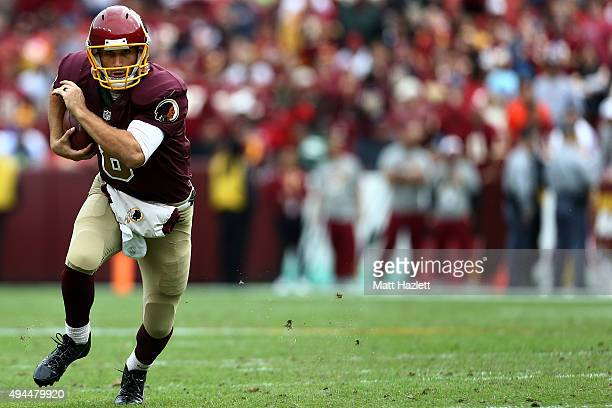 Quarterback Kirk Cousins of the Washington Redskins carries the ball in the third quarter of a game against the Tampa Bay Buccaneers at FedExField on...