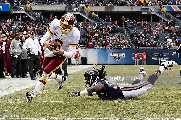 Quarterback Kirk Cousins of the Washington Redskins carries the football into the endzone past Pernell McPhee of the Chicago Bears for a Redskins...