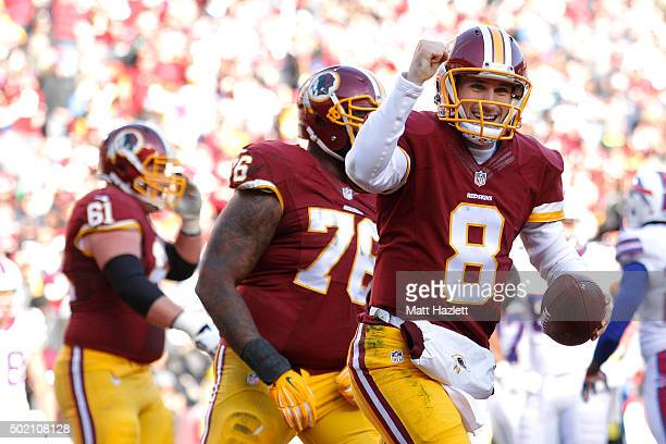 Quarterback Kirk Cousins of the Washington Redskins celebrates after scoring a second quarter touchdown against the Buffalo Bills at FedExField on...
