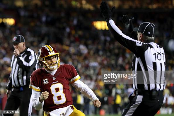 Quarterback Kirk Cousins of the Washington Redskins celebrates after teammate running back Rob Kelley scores a fourth quarter touchdown against the...