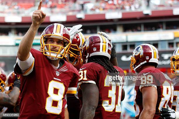 Quarterback Kirk Cousins of the Washington Redskins celebrates with running back Matt Jones of the Washington Redskins after he scores a fourth...