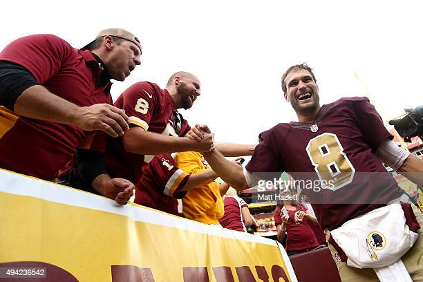 Quarterback Kirk Cousins of the Washington Redskins celebrates with fans after defeating the Tampa Bay Buccaneers 3130 during a game at FedExField on...