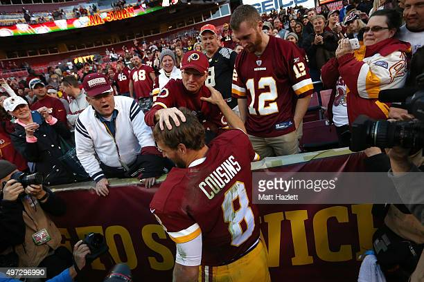 Quarterback Kirk Cousins of the Washington Redskins celebrates with fans after the Washington Redskins defeated the New Orleans Saints 4714 during a...