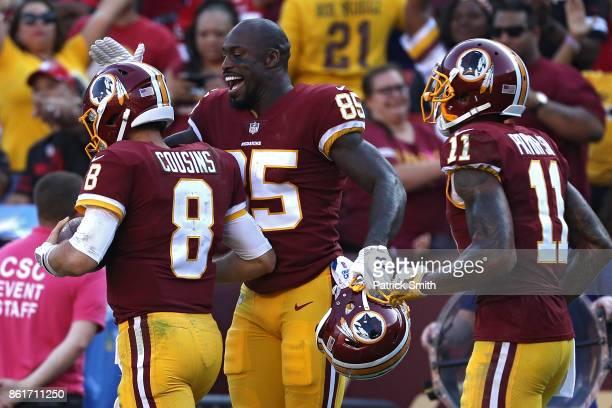 Quarterback Kirk Cousins of the Washington Redskins celebrates with teammate Vernon Davis after scoring a touchdown against the San Francisco 49ers...
