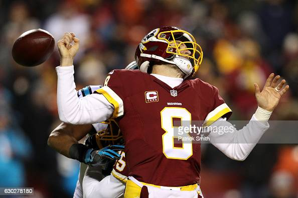 Quarterback Kirk Cousins of the Washington Redskins fumbles the ball in the third quarter against the Carolina Panthers at FedExField on December 19...