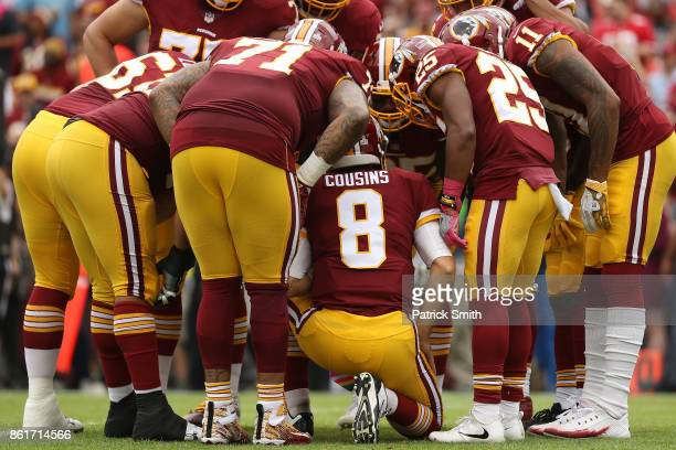 Quarterback Kirk Cousins of the Washington Redskins huddles up with his offense against the San Francisco 49ers during the first half at FedExField...