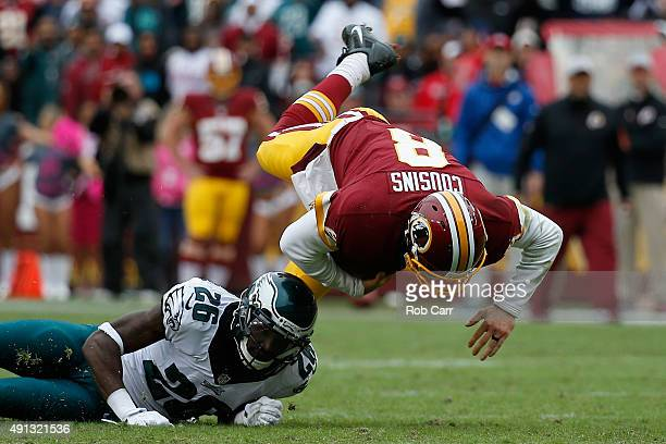 Quarterback Kirk Cousins of the Washington Redskins is tackled by Walter Thurmond of the Philadelphia Eagles in the fourth quarter of the Redskins...