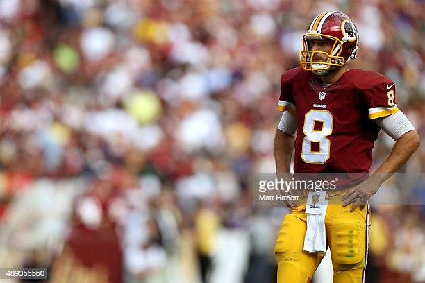 Quarterback Kirk Cousins of the Washington Redskins looks on in the fourth quarter during a game against the St Louis Ramsat FedExField on September...