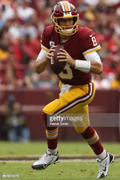 Quarterback Kirk Cousins of the Washington Redskins looks to pass against the San Francisco 49ers during the first half at FedExField on October 15...