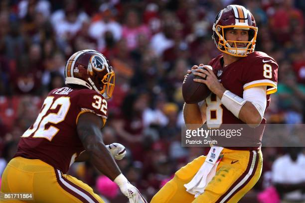 Quarterback Kirk Cousins of the Washington Redskins looks to pass against the San Francisco 49ers during the second half at FedExField on October 15...