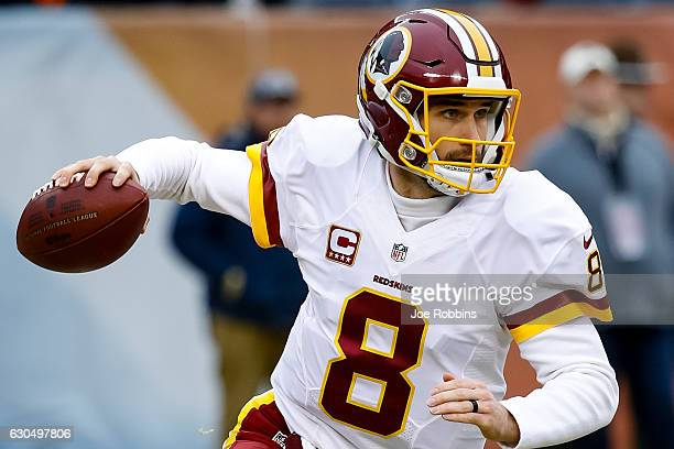Quarterback Kirk Cousins of the Washington Redskins looks to pass the football in the first quarter against the Chicago Bears at Soldier Field on...