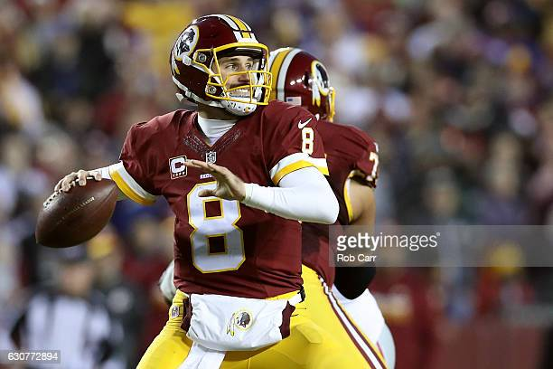 Quarterback Kirk Cousins of the Washington Redskins passes the ball against the New York Giants in the second quarter at FedExField on January 1 2017...