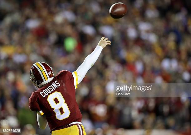 Quarterback Kirk Cousins of the Washington Redskins passes the ball against the New York Giants in the third quarter at FedExField on January 1 2017...