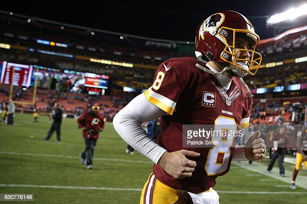 Quarterback Kirk Cousins of the Washington Redskins runs off of the field after the New York Giants defeated the Washington Redskins 1910 at...