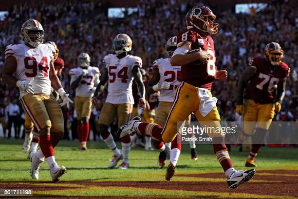 Quarterback Kirk Cousins of the Washington Redskins scores a touchdown against the San Francisco 49ers during the fourth quarter at FedExField on...