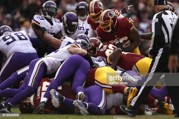 Quarterback Kirk Cousins of the Washington Redskins scores a touchdown during the second quarter against the Minnesota Vikings at FedExField on...