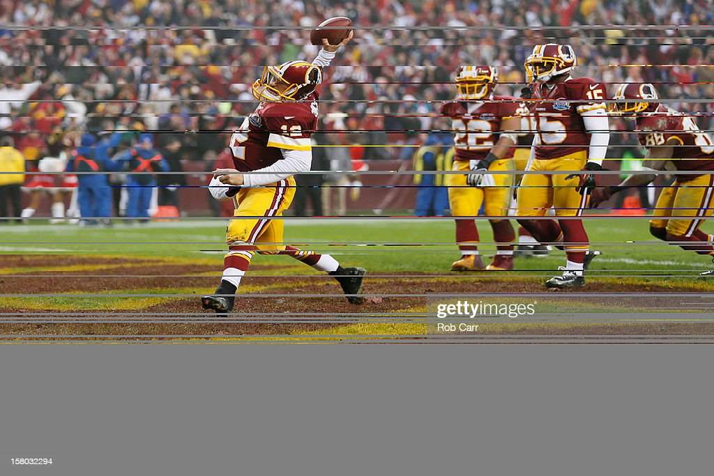 Quarterback <a gi-track='captionPersonalityLinkClicked' href=/galleries/search?phrase=Kirk+Cousins&family=editorial&specificpeople=5571638 ng-click='$event.stopPropagation()'>Kirk Cousins</a> #12 of the Washington Redskins spikes the ball in the endzone after scoring a two point conversion to tie the game with the Baltimore Ravens late in the fourth quarter forcing overtime during the Redskins 31-28 winFedExField on December 9, 2012 in Landover, Maryland.