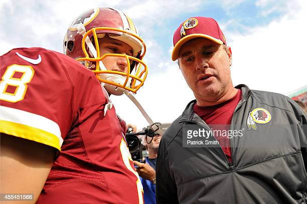 Quarterback Kirk Cousins of the Washington Redskins talks with head coach Jay Gruden after defeating the Jacksonville Jaguars at FedExField on...