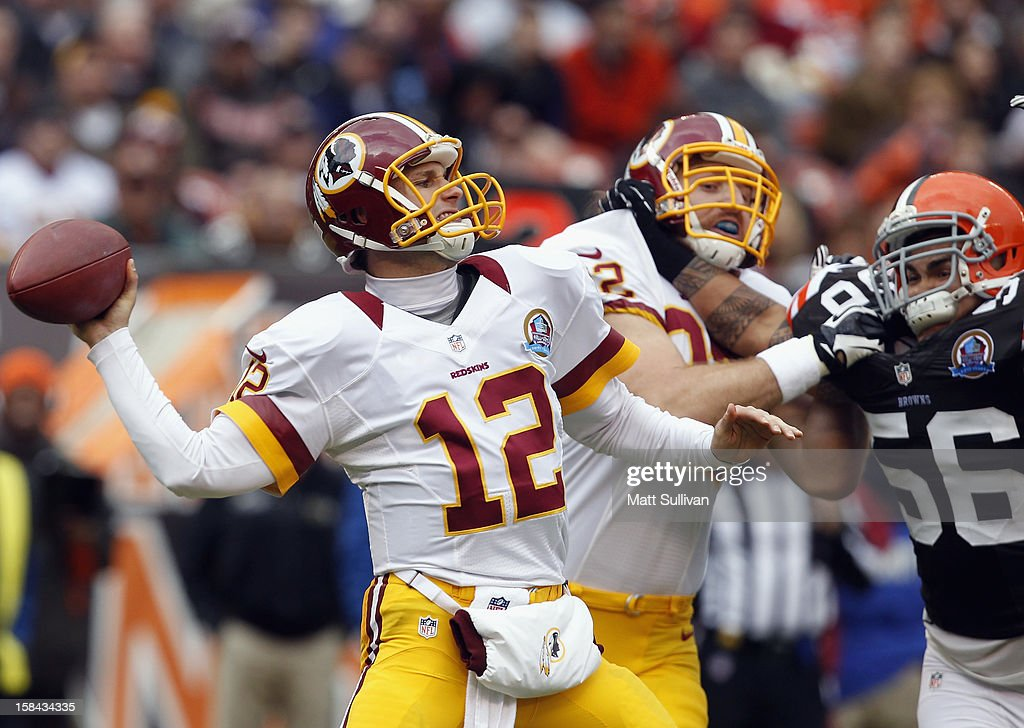 Quarterback <a gi-track='captionPersonalityLinkClicked' href=/galleries/search?phrase=Kirk+Cousins&family=editorial&specificpeople=5571638 ng-click='$event.stopPropagation()'>Kirk Cousins</a> #12 of the Washington Redskins throws a pass as he is pressured by linebacker Kaluka Maiava #56 of the Cleveland Browns at Cleveland Browns Stadium on December 16, 2012 in Cleveland, Ohio.