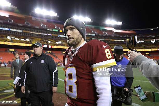 Quarterback Kirk Cousins of the Washington Redskins walks off of the field after the Washington Redskins defeated the Green Bay Packers 4224 at...
