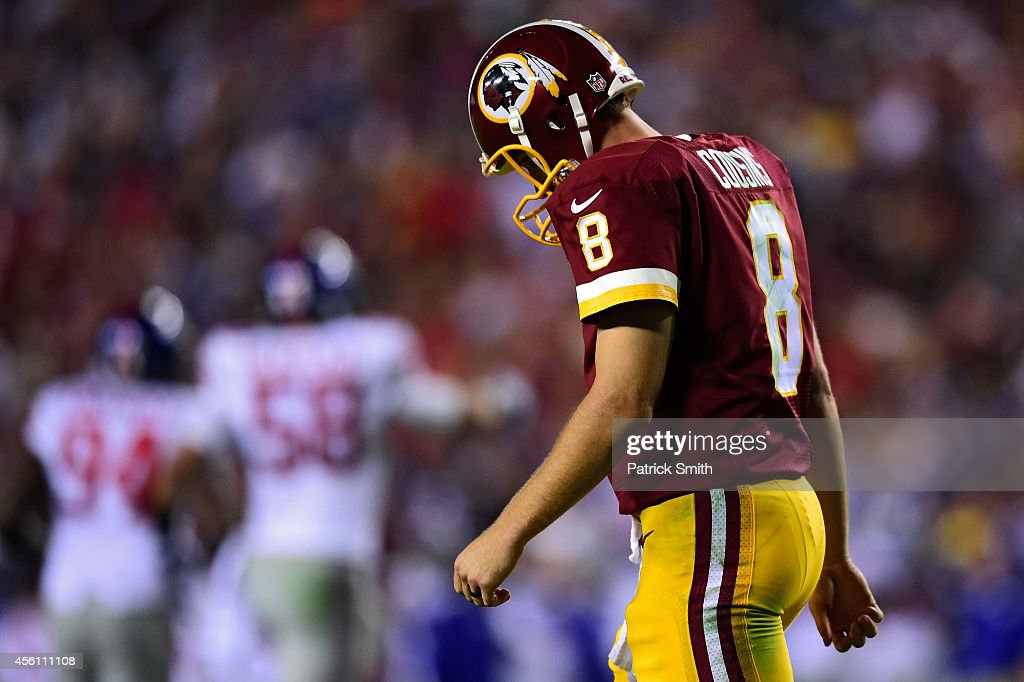 Quarterback Kirk Cousins of the Washington Redskins walks off the field after throwing an interception in the third quarter against the New York...