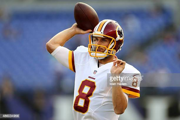 Quarterback Kirk Cousins of the Washington Redskins warms up prior to the start of a preseason game against the Baltimore Ravens at MT Bank Stadium...