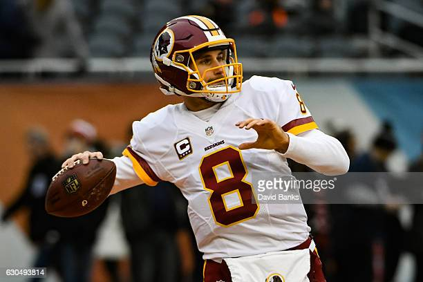 Quarterback Kirk Cousins of the Washington Redskins warms up prior to the game against the Chicago Bears at Soldier Field on December 24 2016 in...