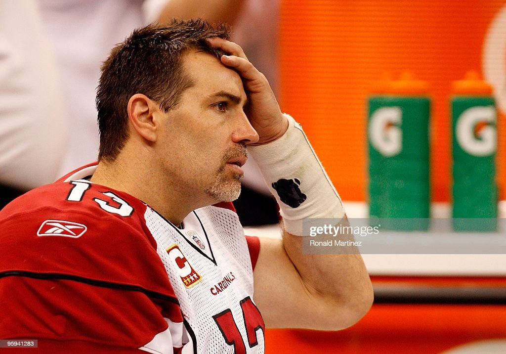 Quarterback <a gi-track='captionPersonalityLinkClicked' href=/galleries/search?phrase=Kurt+Warner&family=editorial&specificpeople=202571 ng-click='$event.stopPropagation()'>Kurt Warner</a> #13 of the Arizona Cardinals looks on dejected from the bench in the second half against the New Orleans Saints during the NFC Divisional Playoff Game at Louisana Superdome on January 16, 2010 in New Orleans, Louisiana.