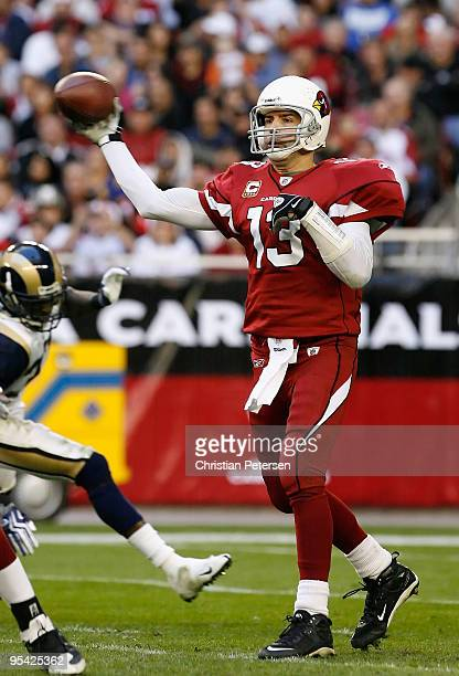 Quarterback Kurt Warner of the Arizona Cardinals throws a pass during the NFL game against the St Louis Rams at the Universtity of Phoenix Stadium on...