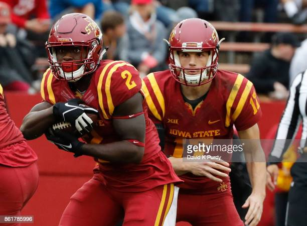 Quarterback Kyle Kempt of the Iowa State Cyclones hands the ball off to running back Mike Warren of the Iowa State Cyclones in the second half of...
