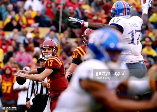 Quarterback Kyle Kempt of the Iowa State Cyclones throws under pressure from defensive end Josh Ehambe of the Kansas Jayhawks in the second half of...