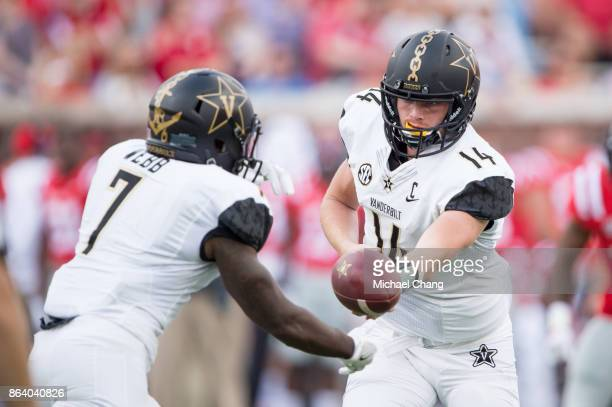 Quarterback Kyle Shurmur of the Vanderbilt Commodores looks to hand the ball off to running back Ralph Webb of the Vanderbilt Commodores during their...