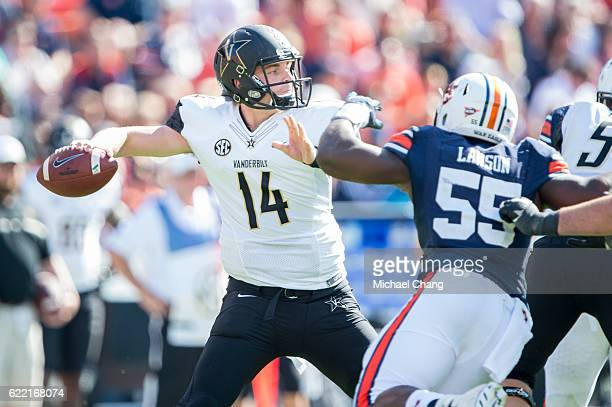 Quarterback Kyle Shurmur of the Vanderbilt Commodores looks to throw a pass in front of defensive lineman Carl Lawson of the Auburn Tigers at...