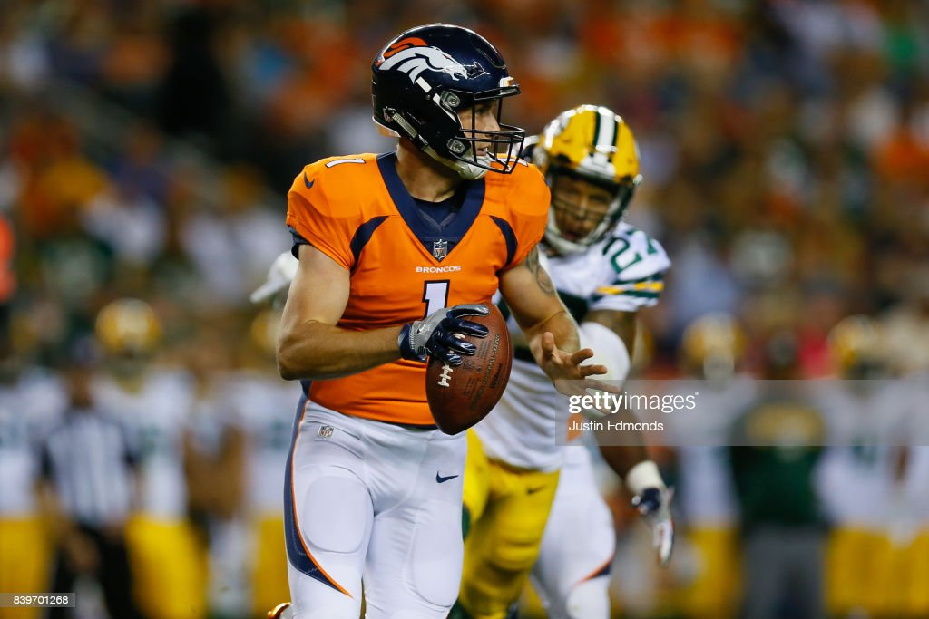 Quarterback Kyle Sloter #1 of the Denver Broncos runs from safety Josh Jones #27 of the Green Bay Packers in the fourth quarter of a Preseason game at Sports Authority Field at Mile High on August 26, 2017 in Denver, Colorado. The Broncos defeated the Packers 20-17.