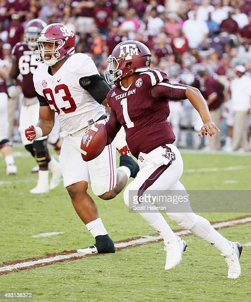 Quarterback Kyler Murray of the Texas AM Aggies runs with the football in front of Jonathan Allen of the Alabama Crimson Tide in the second half of...